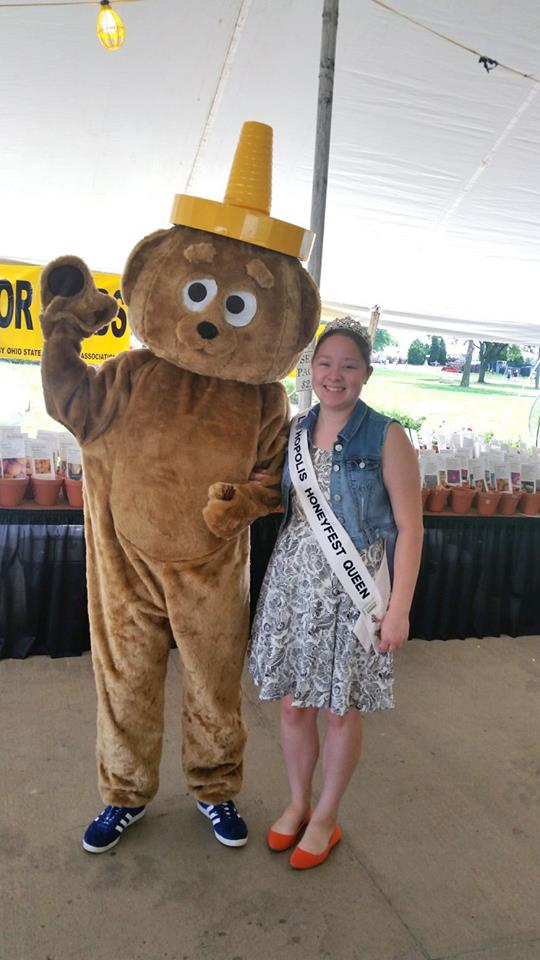 A giant honey bear and contestant winner.