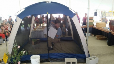 Mike in the tent with the bees.